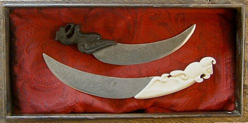 Set of two chinese knives with ebony and bone handles in a mongolian box made of painted wood